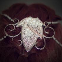 Tocado de plata y perlas